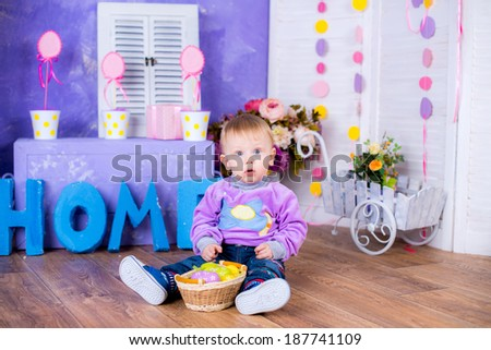 Funny portrait of happy cute boy playing with Easter eggs
