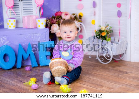 Funny portrait of happy kid playing with Easter eggs