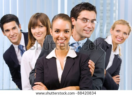 Funny portrait of happy smiling successful business team at office - stock photo