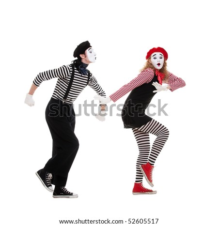 funny portrait of mimes. man want to kiss woman, but woman escaping. isolated on white