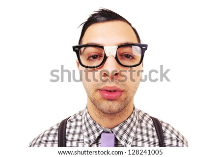 Funny portrait of young nerd with eyeglasses isolated on white background. - stock photo