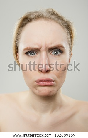 funny portrait of young woman looking disgusted, dorky silly funny face concept