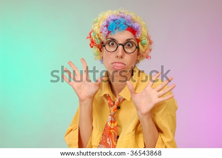 funny portrait of young woman wit wig make faces - stock photo