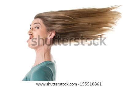 Funny portrait of young woman with flowing hair disappointed. - stock photo