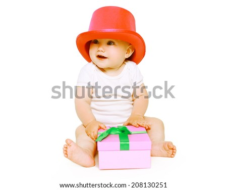 Funny positive baby having fun with toys - stock photo
