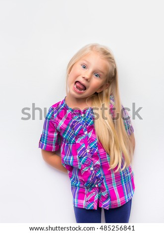 Funny, pretty, young girl hamming on blue background