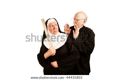 Funny priest admonishes angry nun with ruler as weapon - stock photo