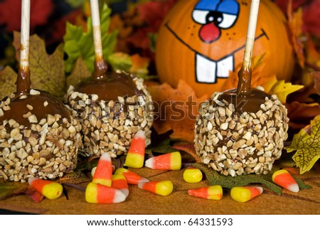 funny pumpkin with caramel apples and candy - stock photo
