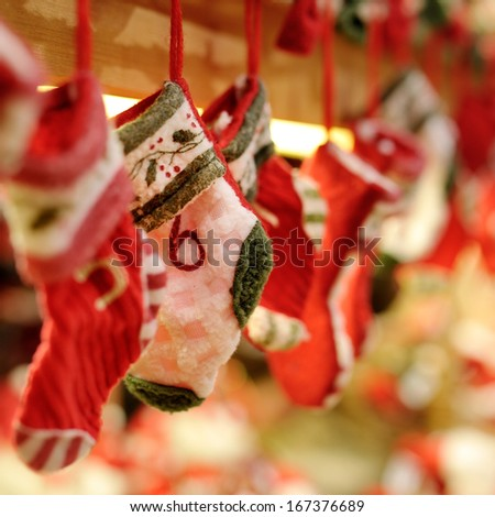 Funny red and white Christmas socks decoration - stock photo
