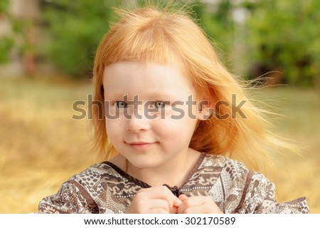 funny red-haired girl with short original bangs cute smiles - stock photo