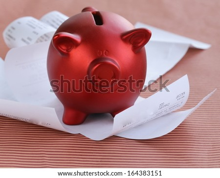 funny red Pig Piggy with lots of receipt - saving concept - stock photo