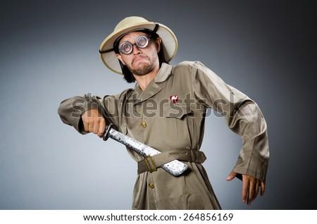 Funny safari hunter against background - stock photo