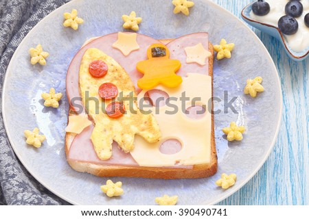 Funny sandwich with rocket and a cosmonaut on the cheese moon - stock photo