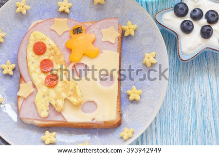 Funny sandwich with rocket and a cosmonaut on the cheese moon