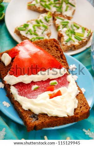 funny sandwich with santa claus as christmas breakfast for child - stock photo