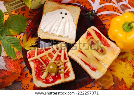 funny sandwiches with ghost,mummy and spider web for halloween party - stock photo