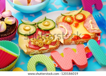 funny sandwiches with owl made from cheese ,sausage and vegetables for child - stock photo