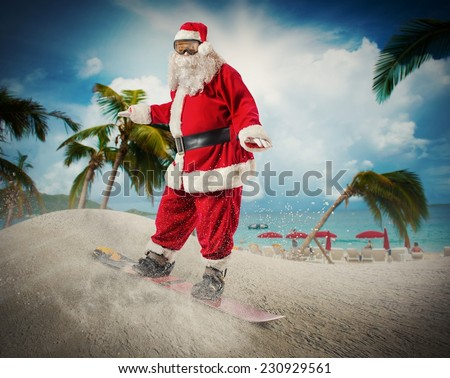 Funny santa claus goes fast on a snowboard in a tropical beach - stock photo