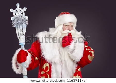 Funny Santa Claus on a black background