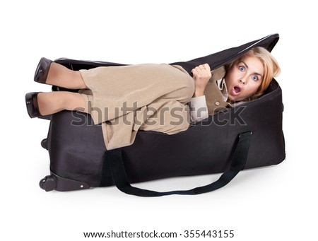 Funny scared girl in a big bag