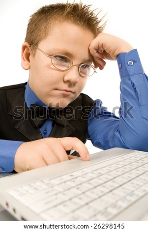 Funny school boy with laptop isolated over white - stock photo