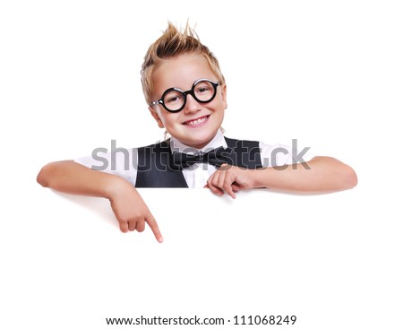 Funny schoolboy in glasses holding the blank board pointing on it with finger - stock photo