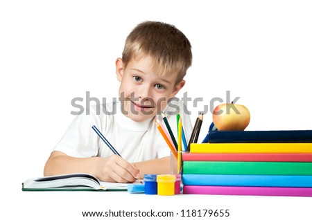 funny schoolboy with books and pencils