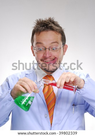 Funny scientist mixing an experimental formule. Scientist mixing chemicals. - stock photo