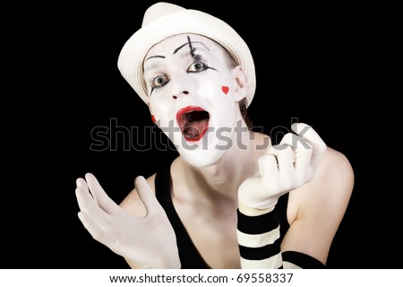 Funny screaming mime in white hat isolated on black background