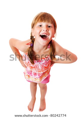 Funny seven years girl looking up laughing isolated - stock photo
