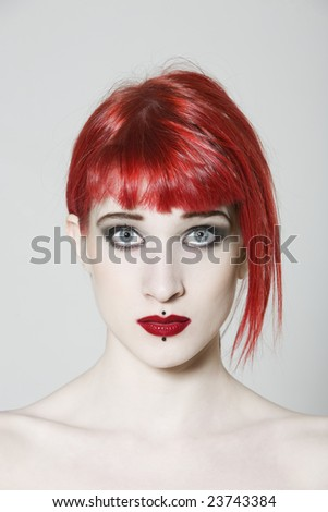 Funny & sexy expressive redhead girl wearing a plastic coat and dress on isolated background - stock photo