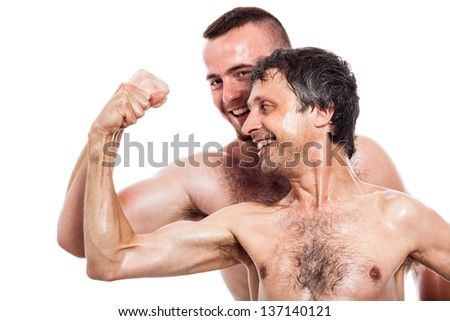 Funny shirtless men comparing biceps, isolated on white background - stock photo