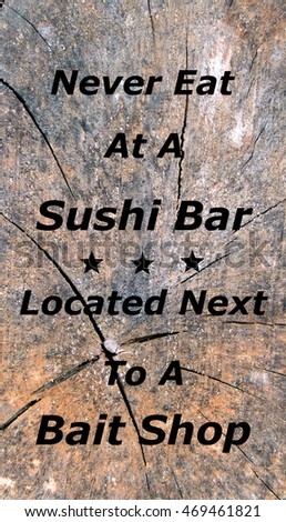 "Funny sign on wooden background reads ""Never Eat At A Sushi Bar Located Next To A Bait Shop""."