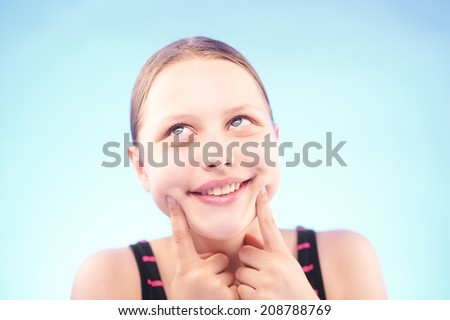 Funny silly teen girl grimacing - stock photo