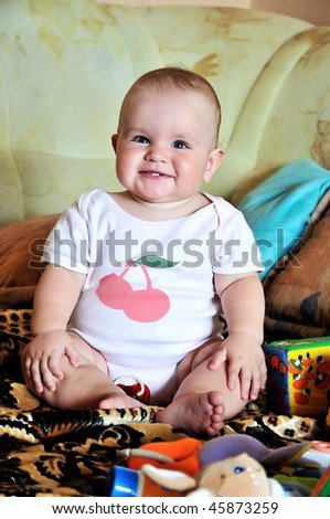 funny sitting baby with her two new tooth