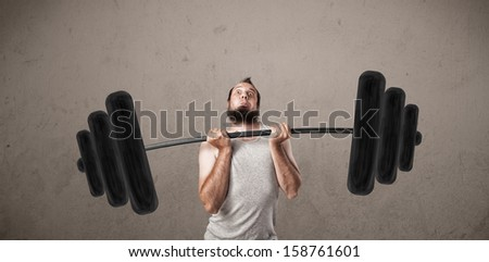 Funny skinny guy lifting incredible weights - stock photo