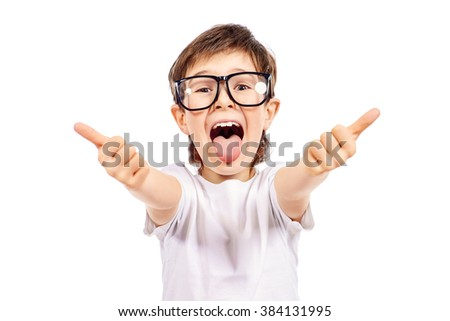 Funny smart boy wearing big glasses showing thumbs. Education. Optics. Studio shot. Isolated over white. - stock photo