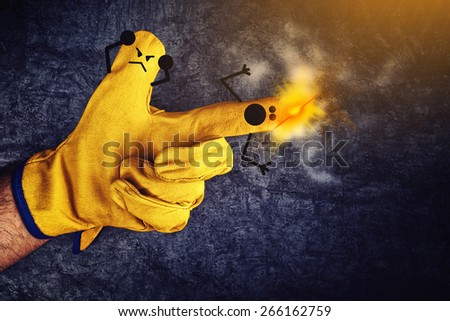 Funny Smileys on Fingers in Protective Yellow Working Gloves, Gun Fire Accident Concept - stock photo