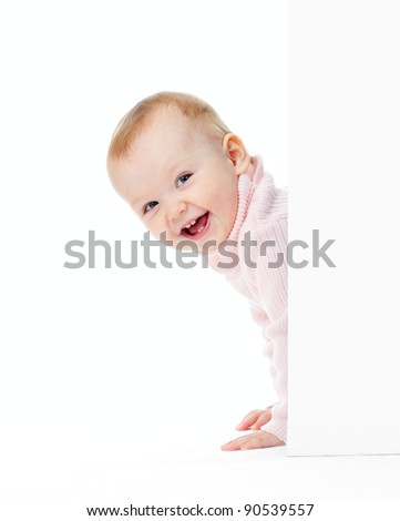 funny smiling girl look out of wall - stock photo
