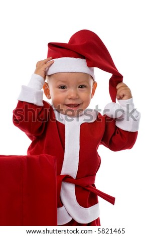 funny smiling little boy in red Santa Claus clothes, isolated on white