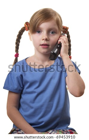 Funny smiling little girl takling by phone portrait isolated over white background - stock photo