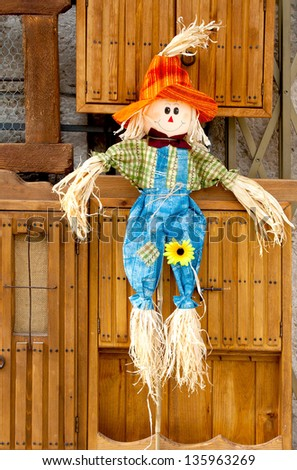 Funny smiling straw doll - stock photo
