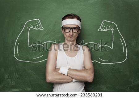 Funny sport nerd with huge, fake, muscle arms drawn on the chalkboard