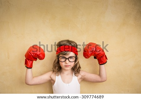 Funny strong child. Girl power and feminism concept - stock photo