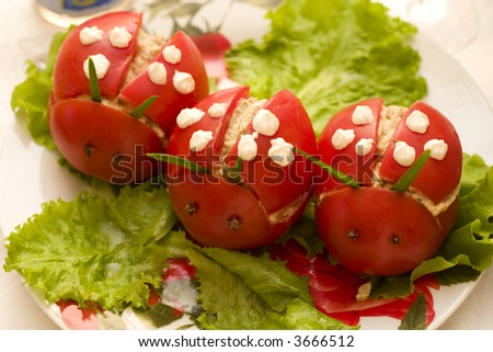 funny stuffed tomatoes designed like ladybirds, special child's food - stock photo