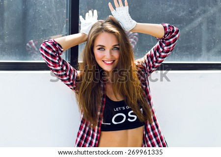 Funny summer fashion lifestyle portrait of amazing pretty young woman with freckles, bright sexy make up and fluffy long hairs, hipster girl having fun, imitate bunny ears. - stock photo