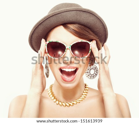 Funny summer portrait of girl in hat, holding sunglasses with hands
