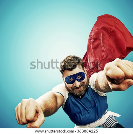 Funny superman, lots of copyspace - stock photo