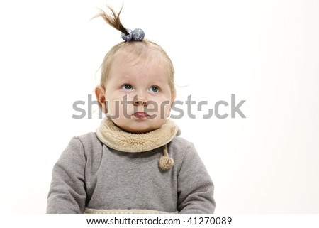 funny surprised baby in gray dress - stock photo