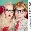 Funny surprised nerdy couple - stock photo